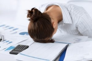 picture of woman sleeping at work